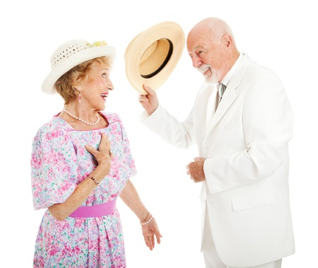 Southern gentleman tipping his hat to a pretty southern belle. Isolated on white photo