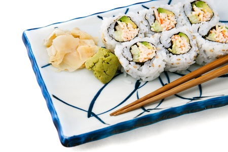 california roll: Japanese food - california roll served with wasabi and ginger.  White background