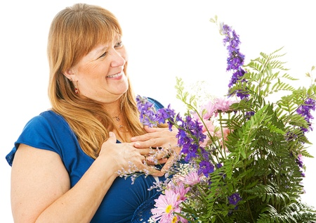 ly: Pretty blond woman receiving a beautiful bouquet of flowers.  Isolated on white.