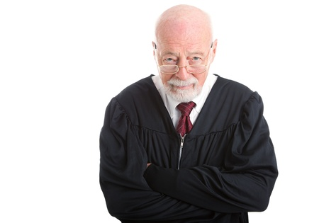 banging: Wise old judge isolated on white background, with a skeptical expression
