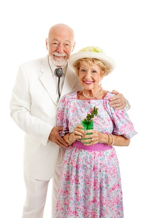 kentucky derby: Portrait of beautiful Southern senior couple dressed for Kentucky Derby Day or a party and holding a mint julep.