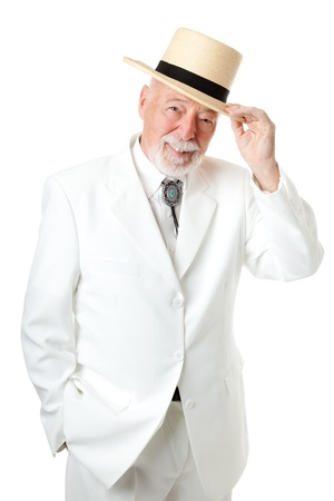 chivalry: Handsome Southern senior man tipping his hat, with old fashioned chivalry.  Isolated on white.