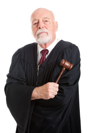 court judge: Stern judge holding his gavel, isolated on white.