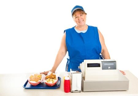 친절한 패스트 푸드 작업자는 음식을 제공하고 금전 등록기를 실행합니다. 흰색 배경입니다. 스톡 콘텐츠