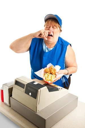 Unhygienic fast food worker sneezing on someone's meal.  White background.   Stockfoto