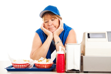 fast service: Mature adult fast food worker bored with her job.  Isolated on white.