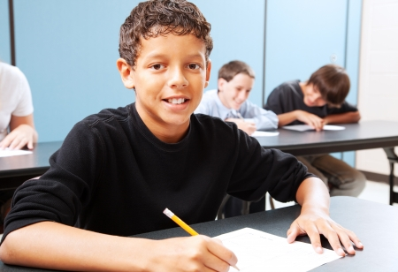 hispanic boy: Handsome mixed-race student in class, ready to learn.