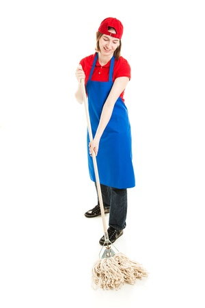 Happy smiling teenage worker, mopping the floor.  Isolated on white.   photo