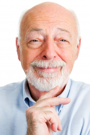old man beard: Closeup portrait of smiling senior man over a white background.   Stock Photo