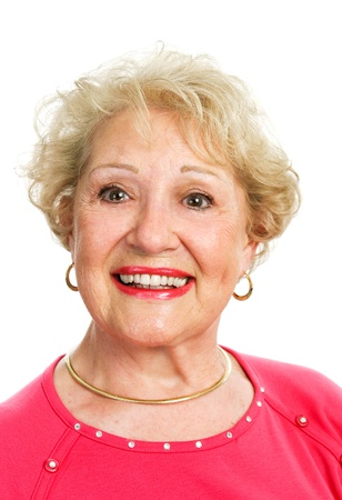 false teeth: Headshot of a beautiful blond senior lady, isolated on white.