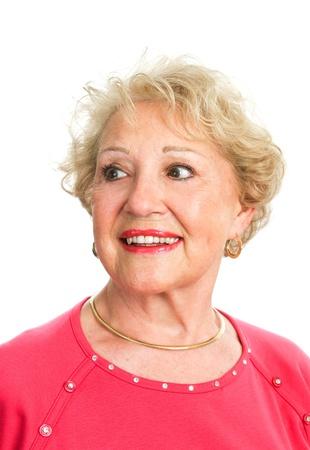 false teeth: Portrait of a beautiful senior woman looking off camera.  Isolated on white.   Stock Photo