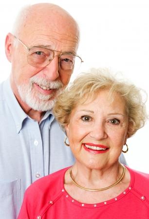 dentures: Portrait of happy senior couple isolated on white background.   Stock Photo
