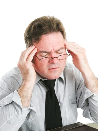 Pain Management: Closeup of a businessman rubbing his temples to relieve a headache.  White background.