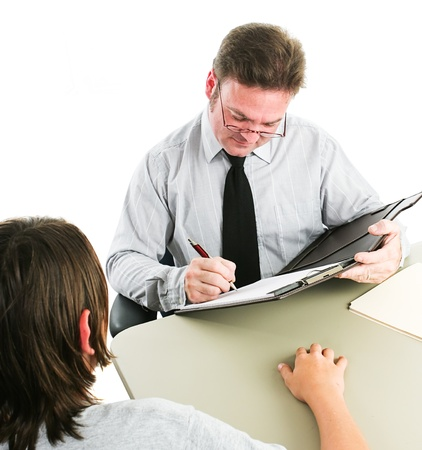 principal: Man interviewing a teenage boy, either for a job, or as a counselor.  White background.   Stock Photo
