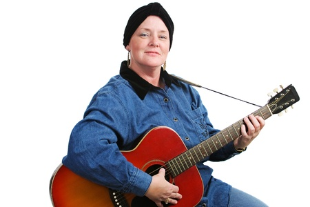 Guitarist undergoing chemotherapy treatment for cancer, wearing a turban to cover her hair loss   Isolated on white    photo