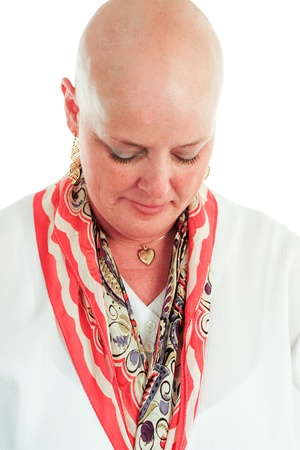 Cancer survivor has lost her hair as a result of chemotherapy   White background