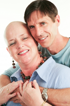 cancer woman: Loving husband supporting his wife through her cancer treatment