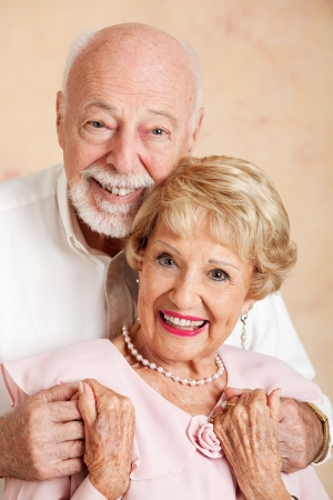 Head and shoulders portrait of a happy, beautiful senior couple    photo