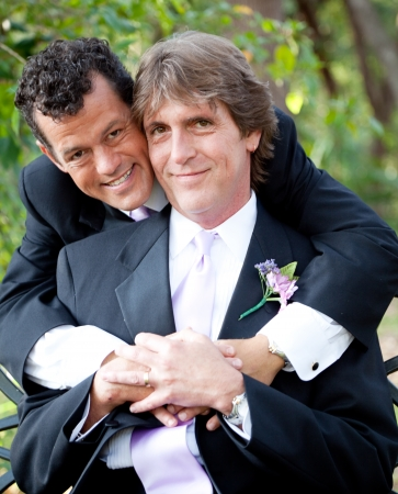 gay boy: Portrait of a handsome gay couple in their wedding tuxedos.