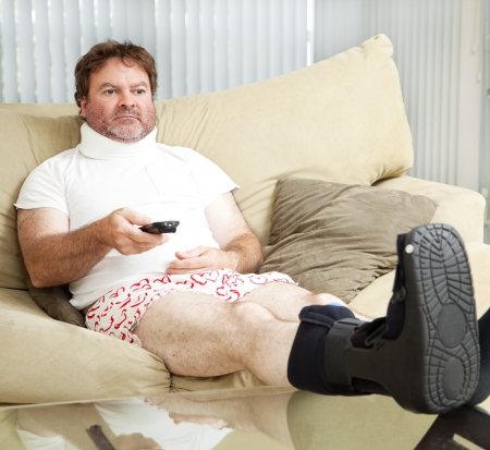 Man injured in a car or workplace accident, stuck at home in his underwear.