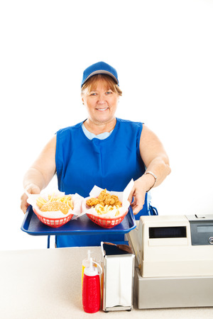 Restaurant worker serving two fast food  meals with a smile.  Isolated on white.   photo