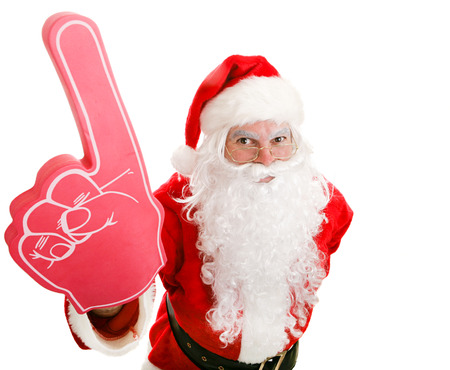 Santa Claus holding up a number one foam finger.  Isolated on white.   photo