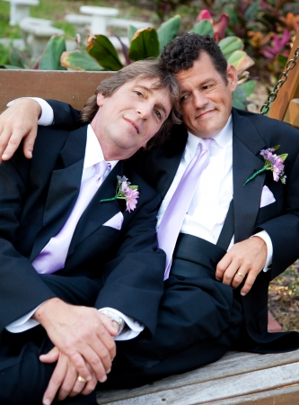 Portrait of a loving gay male couple on their wedding day.   photo