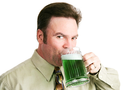 Handsome Irish-american man drinking green beer for St. Patricks day.  Isolated on white.   photo