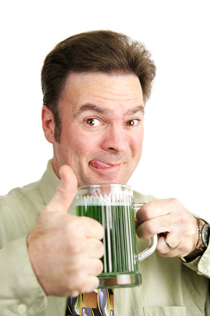 irish ethnicity: Drunk Irish man gives a thumbs up on St. Patricks Day as he drinks a green beer.  White background.   Stock Photo