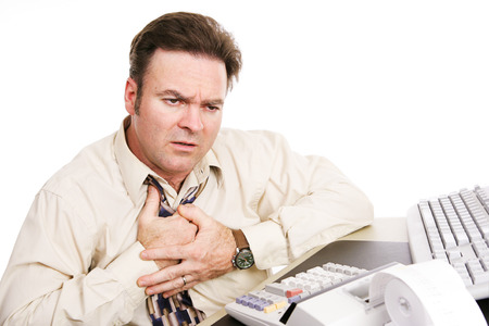indigestion: Businessman with financial problems experiencing indigestion or a heart attack. White background.   Stock Photo