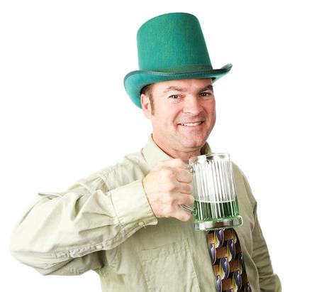 irish ethnicity: Handsome Irish American man celebrating St Patricks Day with green beer.  Isolated on white.