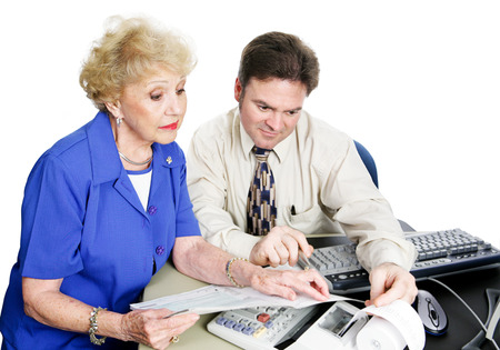 Senior woman consulting accountant about her taxes and financial planning.  White . Stock Photo - 25913859