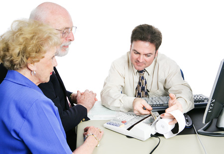 Senior couple consulting an accountant to help with taxes and financial planning. photo