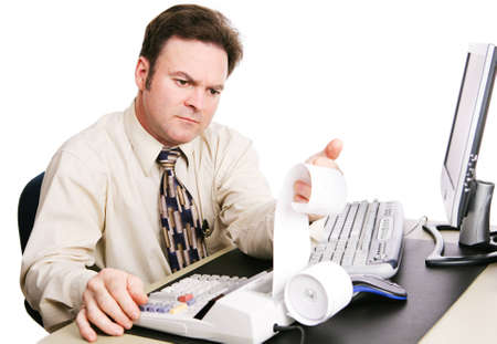 Accountant working on finances and looking serious.  White background.