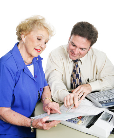 Accountant giving financial advice to a senior woman.  White background.