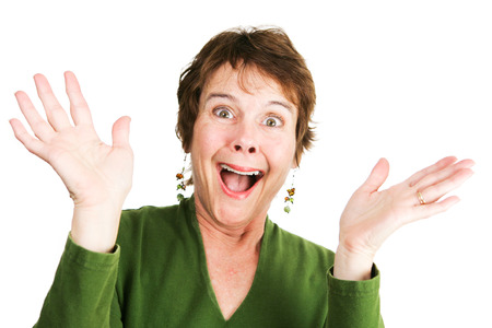overjoyed: Humorous photo of a mature woman excited and overjoyed.  Isolated on white.