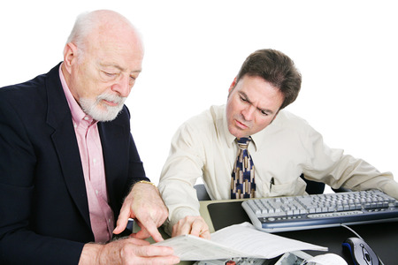 taxes budgeting: Senior man going over his taxes with an accountant.  White background