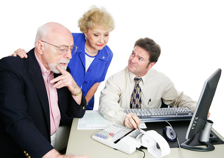 Senior couple getting financial advice from their accountant.  White background.   photo