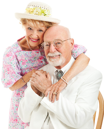 Formal portrait of a traditional Southern senior couple in love.  White background.   photo