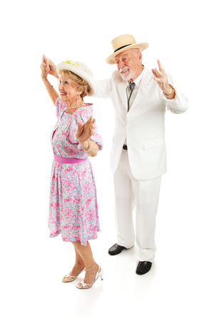 Senior couple dressed in Southern style, dancing together.  Isolated on white.