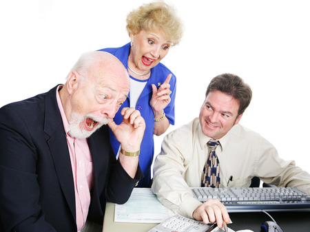 Seniors with their accountant, excited about getting a big tax refund.  White background photo