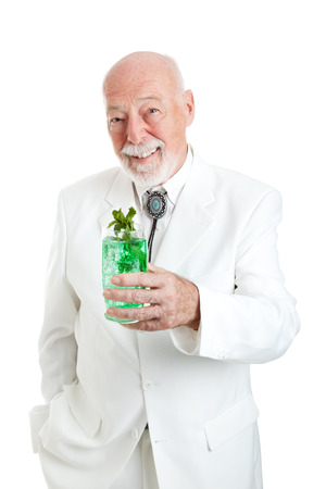 colonel: Traditional Kentucky Colonel enjoying a mint julep coctail for Derby Day.  Kentucky Colonel is an honorary designation, not only associated wiith a particular brand.