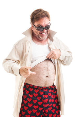 underpants: Humorous photo of a scruffy middle aged man lifting his shirt and pointing to his overweight stomach.  Isolated on white.