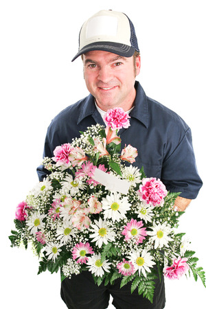 Delivery man delivers a bouquet of flowers for Mothers Day, birthday, or other special occasion.  Isolated on white.   Reklamní fotografie