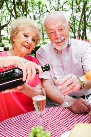 Senior couple on a romantic picnic.  Stock Photo - 28559053
