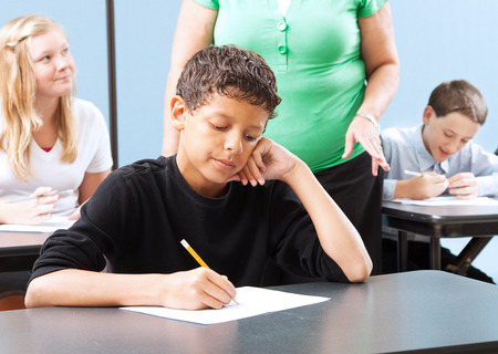 standardized: Student struggling with a standardized test in school.