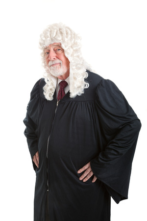 magistrate: Serious looking judge wearing a wig.  Isolated on white.