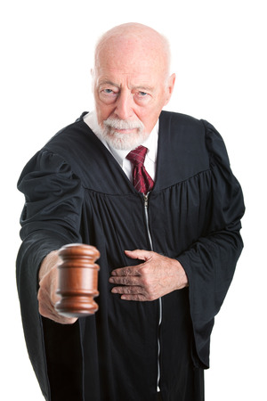 banging: Serious judge banging his gavel in court.  Isolated on white.