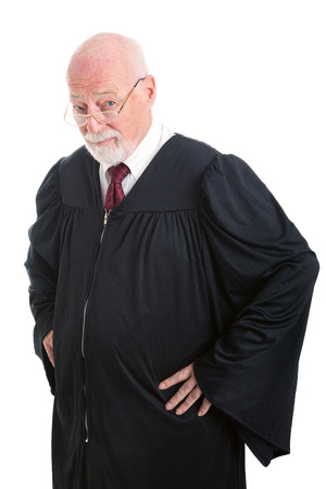 skepticism: Experienced judge with serious expression.  Isolated on white.