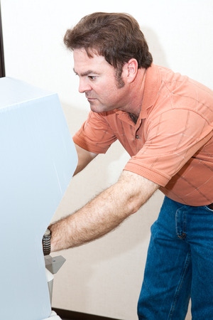 voting: Mid adult man voting on a new touch screen machine.   Stock Photo